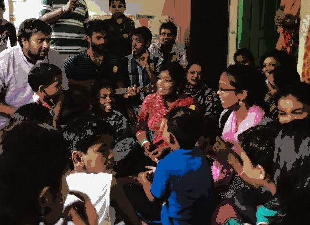 Picture of volunteers and children gathered together for a sing-a-long session.