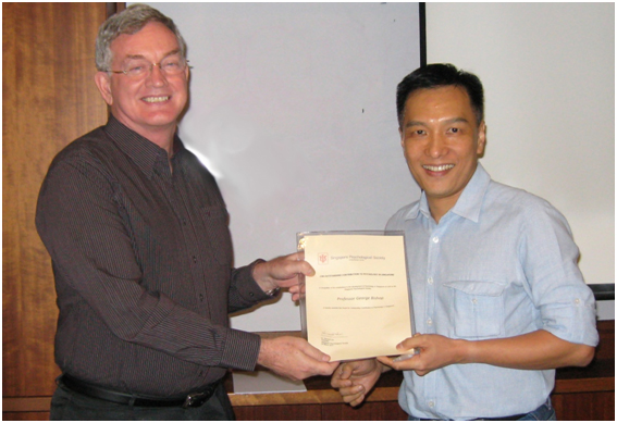 Prof Bishop receiving  the Outstanding Contribution to Psychology in Singapore Award from Singapore Psychological Society President COL Bernard Lim. Photo courtesy of http://www.fas.nus.edu.sg/srn/?meet-the-researcher=prof-george-bishop