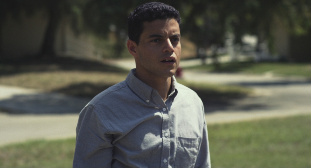 Nate (Rami Malek), a new worker who learns the ropes as the movie progresses.
