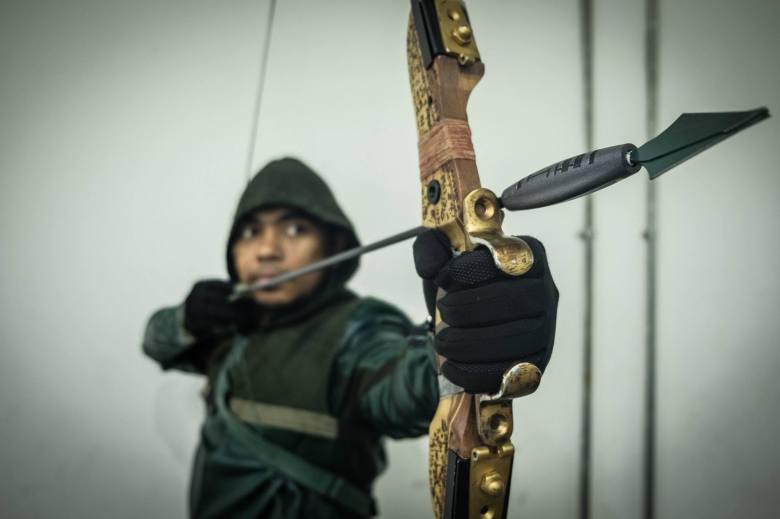 Ihsan posing in his Green Arrow costume