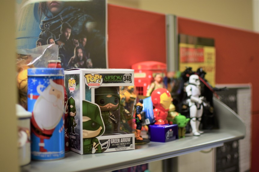 A shelf in Ihsan's cubicle, featuring various pop culture figurines